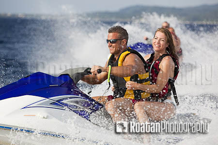 Excited_couple_riding_jetski