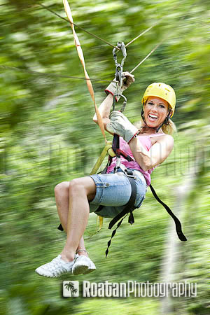Excited_woman_on_zipline_in_jungle_motion_blur
