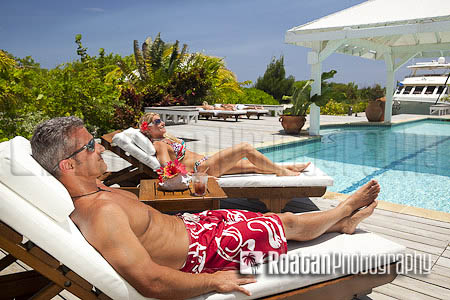 Mature couple enjoying relaxing vacation poolside