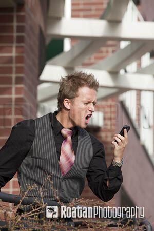businessman_yelling_into_phone