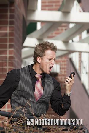 Upset businessman on phone