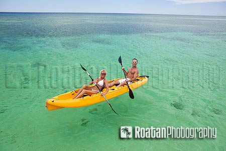 Happy couple kayaking in Caribbean Sea Stock Photo