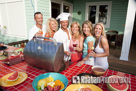 Happy group of friends enjoying BBQ stock photo