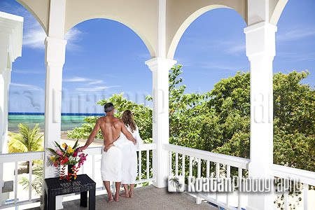 Romantic couple overlooking scenic Caribbean Sea stock photo