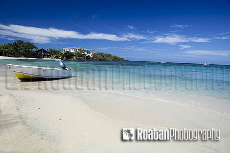 Small skiff beached on caribbean beach west end stock photo