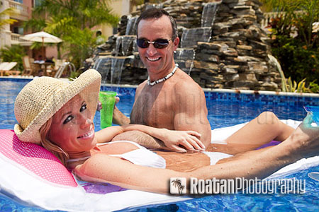 Athletic couple smiling and enjoying swimming pool stock photo