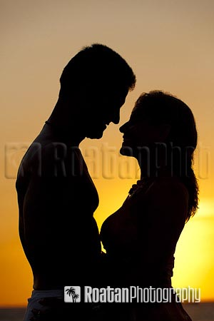 Couple embracing sunset silhouette stock photo