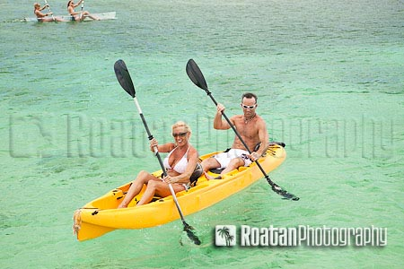 Couple kayaking in yellow kayak in Caribbean Sea stock photo