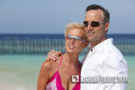 Portrait of adult couple on beach stock photo
