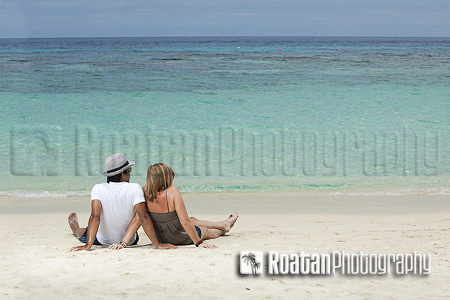 Young couple relaxing on tropical beach