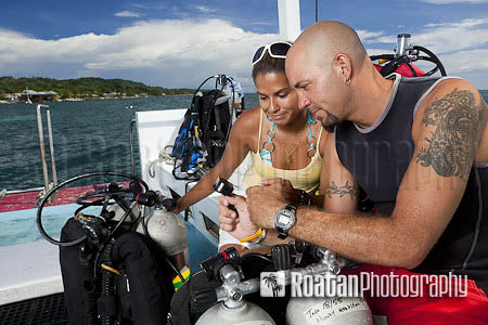 Buddies reviewing dive plan stock photo