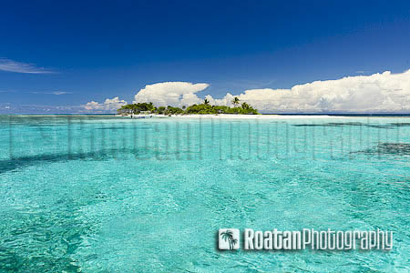 Tropical island surrounded by clear sea stock photo